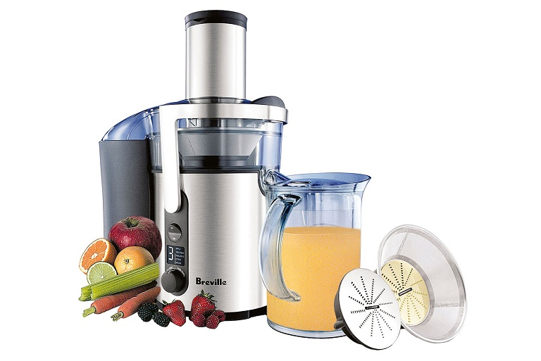 The Breville Froojie Juicer surrounded by fruits and vegetables