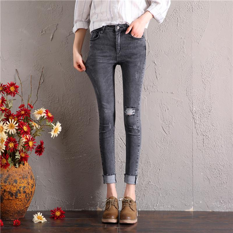 Celana jeans wanita 2019 Musim Dingin Gaya Korea Highwaist abu-abu asap berlubang kaki Kacil