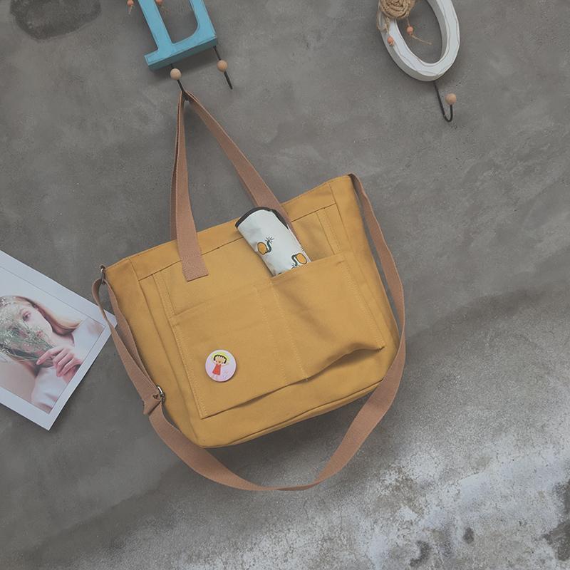ปทุมธานี กระเป๋าผ้าใบหญิงไหล่ข้างเดี่ยวความจุขนาดใหญ่กระเป๋าสะพายข้างหญิงเข้าได้หลายชุด INS เสื้อผ้าแฟชั่น เสื้อผ้าแฟชั่น กระเป๋าผ้าแบบเย็บสไตล์เกาหลีนักเรียนลำลองกระเป๋าสะพายขนาดใหญ่สไตล์ญี่ปุ่น